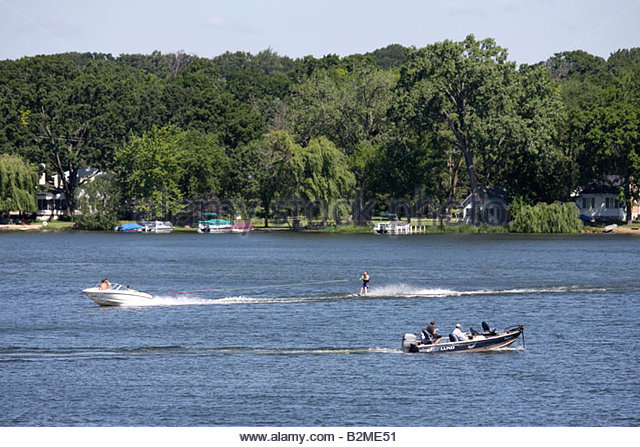 Wisconsin Kenosha Paddock Lake Old Settlers Park motor boat water skiing skier sport recreation speed fun fish - Stock Image