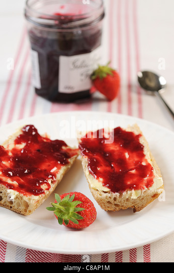 Bread,butter and strawberry jam - Stock Image