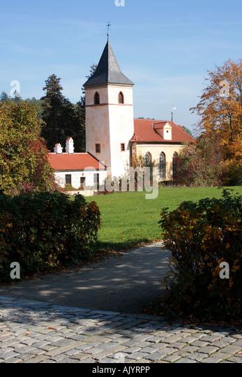 water castle Bohemia church Kratochville Czech Republic. Photo by Willy Matheisl - Stock Image