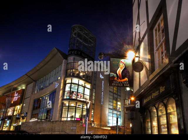 Sinclairs Oyster Bar Pub , Manchester at Dusk , Harvey Nichols store in the background , England UK - Stock Image