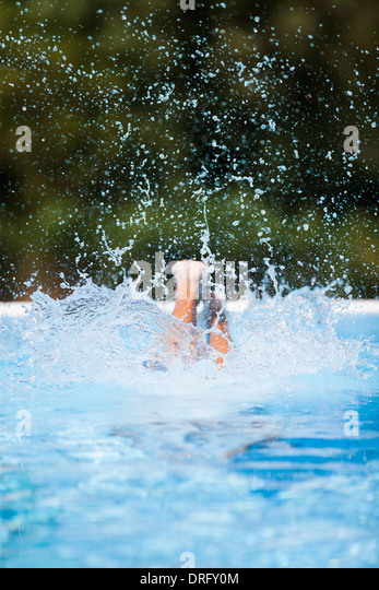 Taking the plunge, woman diving into pool, Dubrovnik, Croatia - Stock Image