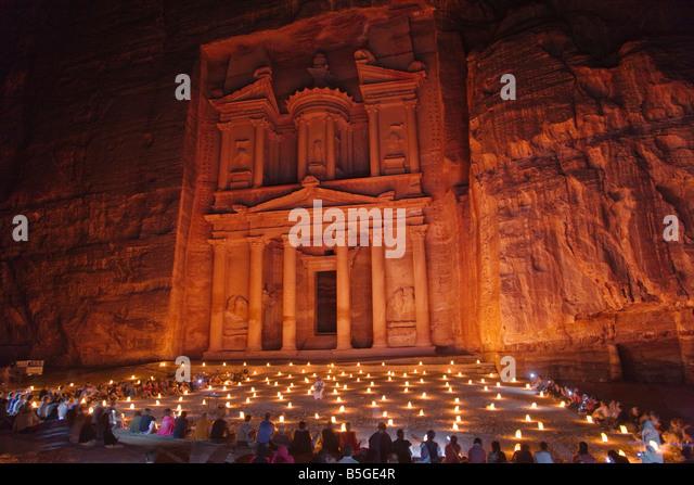 Night view of candles burning at Facade of Treasury Al Khazneh Petra Jordan - Stock Image
