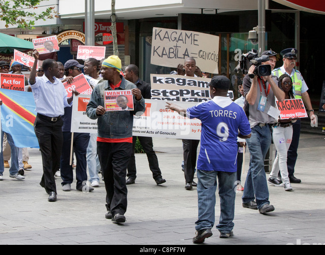 Protesters demonstrating against Rwandan President Paul Kagame at CHOGM 2011. - Stock Image