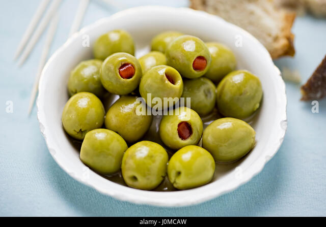 Green olives stuffed red peppers - Stock Image