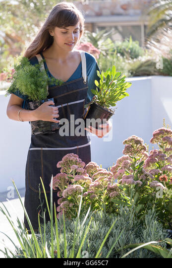 Beautiful young woman gardening - Stock Image
