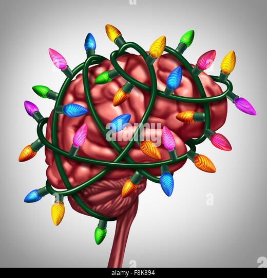 Holiday thinking and christmas memories concept as bright festive lights wrapped around a human brain as a metaphor - Stock Image