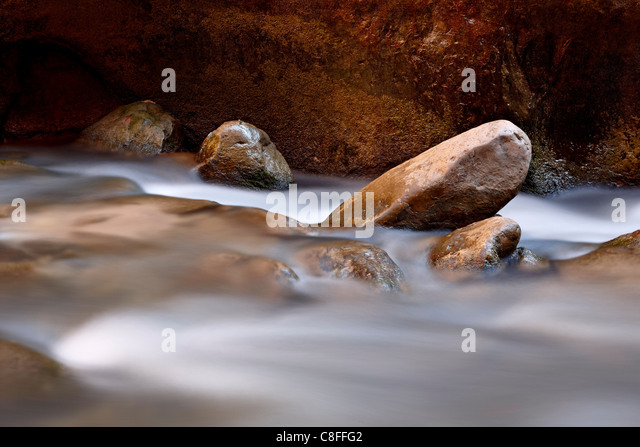 Round rocks in the Virgin River near The Narrows, Zion National Park, Utah, United States of America - Stock Image