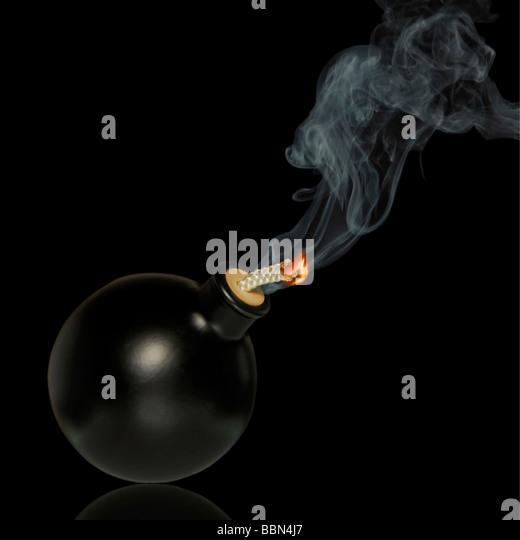 Black bomb on black, fuse is burning, symbolic symbol for danger, let the bomb explode - Stock Image