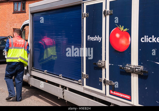 A Tesco delivery van delivering groceries in the Uk - Stock Image
