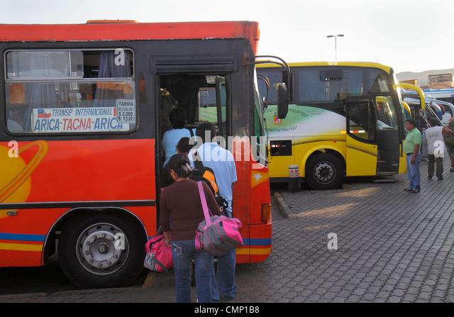 Chile Arica bus motor coach station Hispanic intercity transportation boarding Hispanic man woman baggage line queue - Stock Image