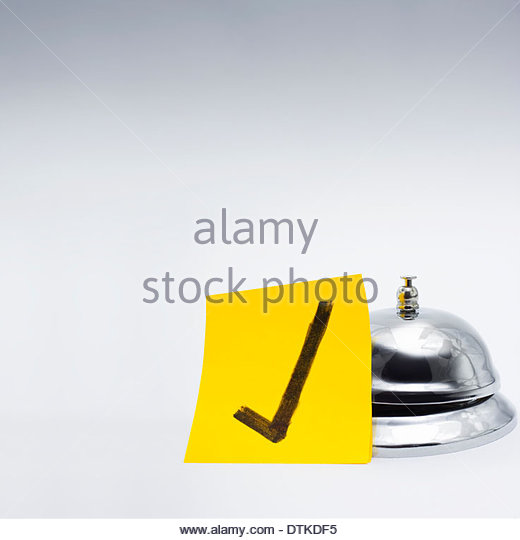 Retail service bell accompanied by a gold class approval tick in a depiction of good customer service - Stock Image