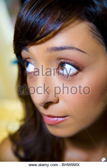 A young woman looking away - Stock Image