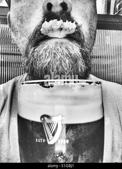 Guinness in moustache. - Stock-Bilder