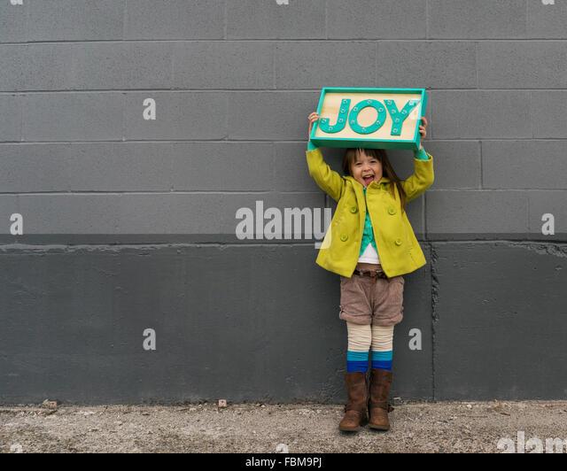 Happy girl holding a joy sign - Stock-Bilder
