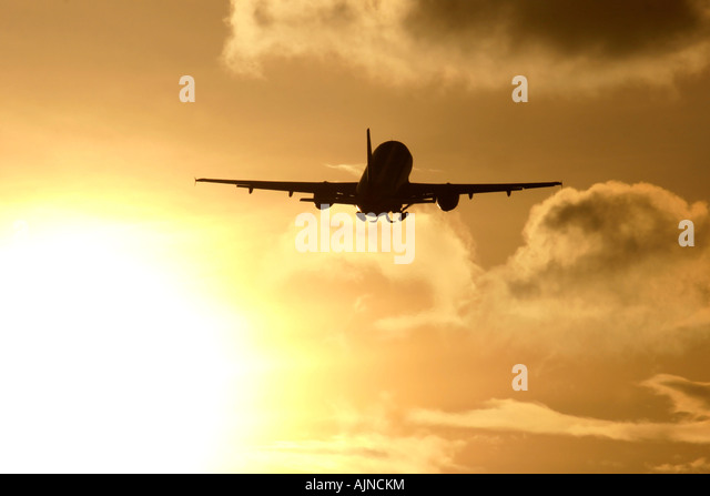 Commercial airplane during flight in clouds - Stock Image