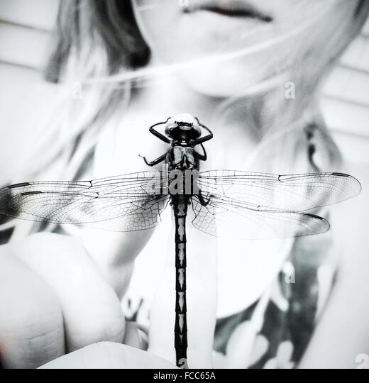 Close-Up Mid Section Of A Young Woman With Winged Insect - Stock Image
