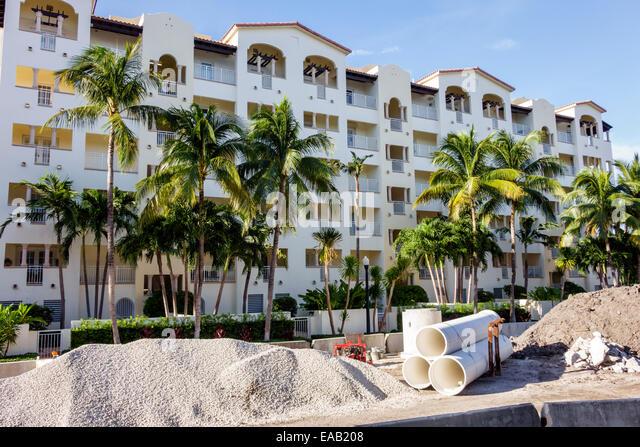 Miami Beach Florida road repair capital improvements construction site condominium building - Stock Image