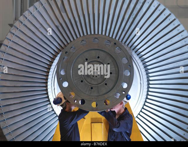 Engineers Working On Turbine - Stock-Bilder