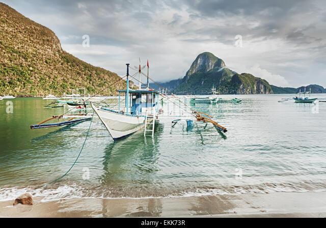 Traditional philippine boats bangka in lagoon of El Nido - Stock Image