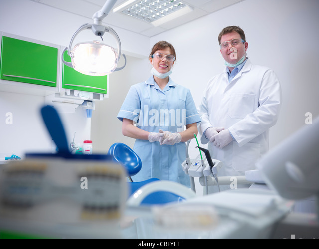Dental student and dentist in surgery - Stock Image