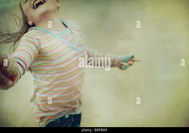 girl swinging round with a smile - Stock-Bilder