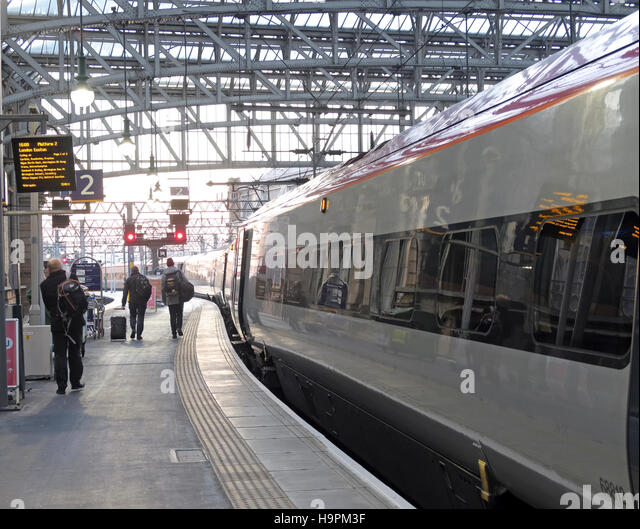 Glasgow Central Station - Passengers boarding Euston West Coast Main Line Train - Stock Image