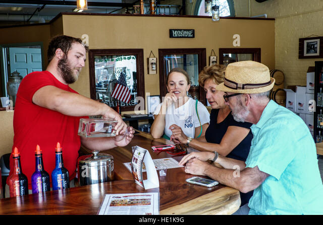 Tampa Florida Ybor City historic neighborhood Florida Cane Distillery tasting free sample bar - Stock Image