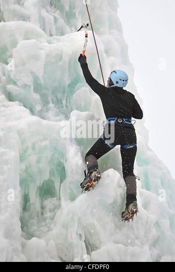 Woman ice climbing, Festival du Voyageur, Winnipeg, Manitoba, Canada. - Stock Image