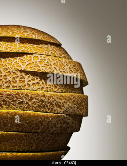 Close up of stack of melon slices - Stock Image