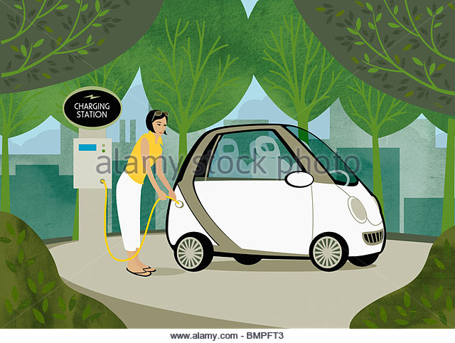 Woman recharging her electric car among trees - Stock Image