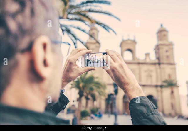 Spain, Canary Islands, Gran Canaria, Las Palmas, man taking picture of Catedral de Santa Ana - Stock-Bilder