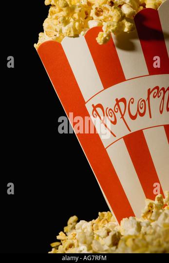 Overflowing popcorn - Stock Image