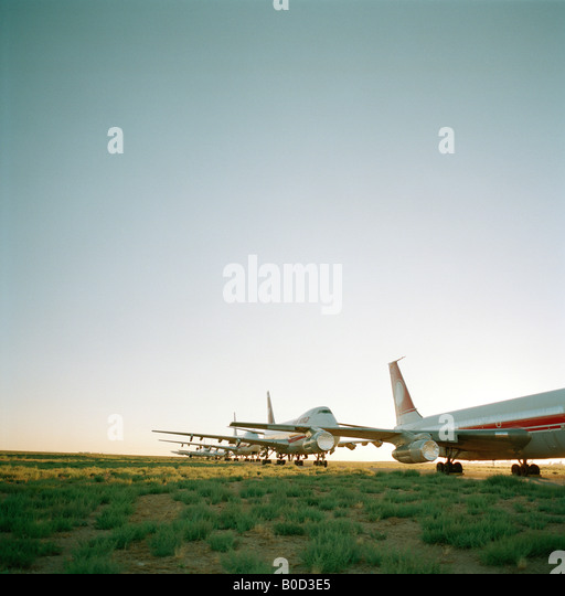 Stored old airliners sit in mid-day heat of arid Sonoran Desert at Mojave airport facility awaiting recycling for - Stock Image
