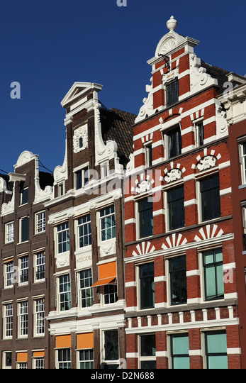 Traditional facades of Dutch townhouses in Amsterdam, The Netherlands, Europe - Stock Image