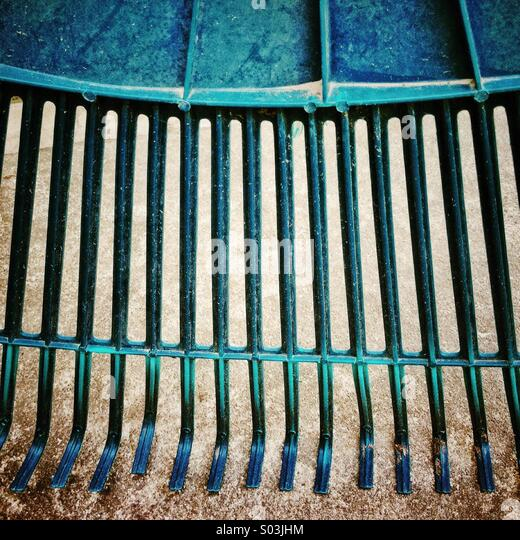 Abstract of green garden and lawn  rake. - Stock Image