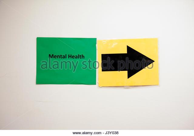 Miami Florida Liberty City Jessie Trice Community Health Center fair free care exam mental health sign arrow direction - Stock Image