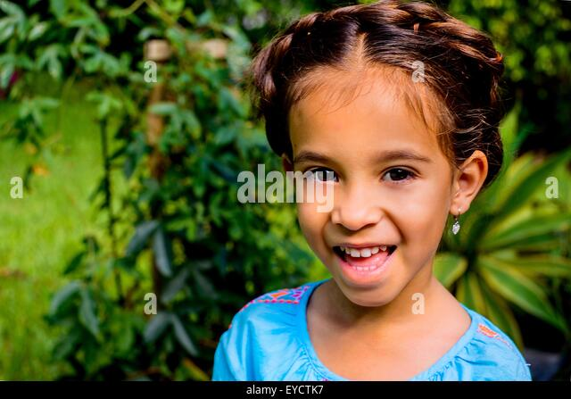 Portrait of pretty girl in garden - Stock Image