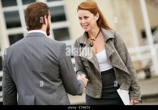 Two business people greeting each other - Stock-Bilder