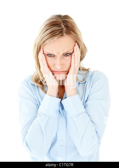Downcast businesswoman taking her head between her hands - Stock Image
