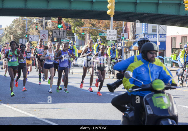 Front female runners along 4th Avenue in Brooklyn during the New York City Marathon. - Stock Image