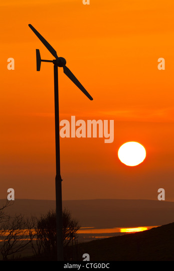 Wind turbine with sunset - Stock Image