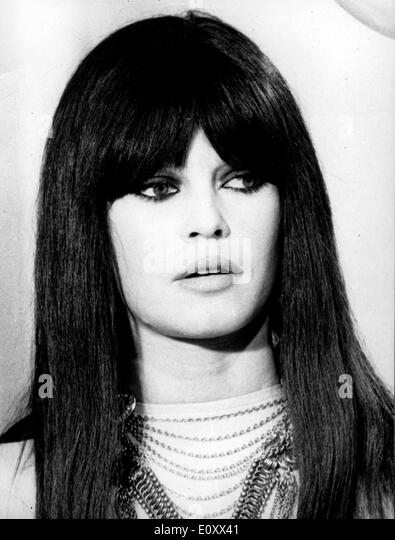 Portrait of actress Brigitte Bardot wearing a brown wig - Stock Image