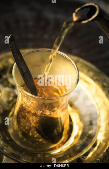 Pouring tea into Turkish glass - Stock Image
