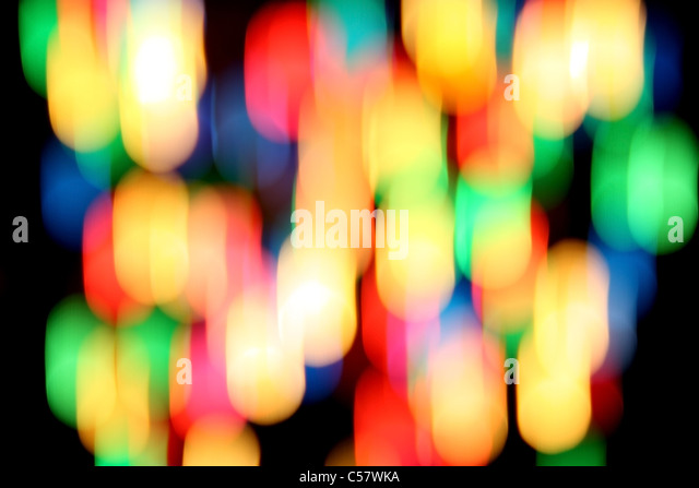 Multicolored spots of light against a black background - Stock Image