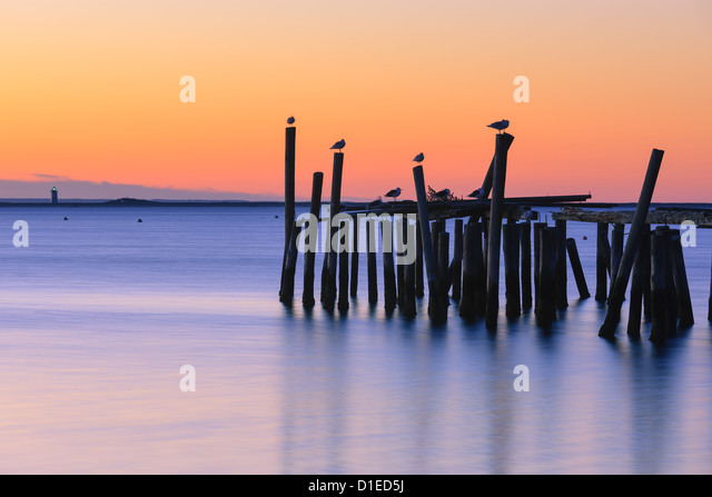 Sunrise over the old jety in Provincetown on the north of Cape Cod, Massachusetts - Stock Image