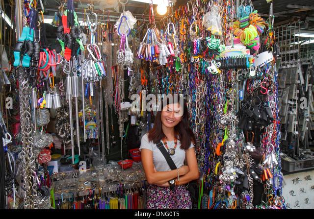Hong Kong China Kowloon Sham Shui Po Pei Ho Street market marketplace vendor stall shopping buying selling sale - Stock Image