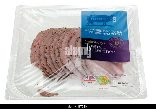 Sainsburys taste the difference peppered dry cured British ham slices in a cellophane sealed packet - Stock Image