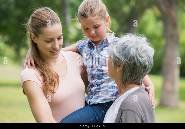 Grandmother mother and daughter at park - Stock Image