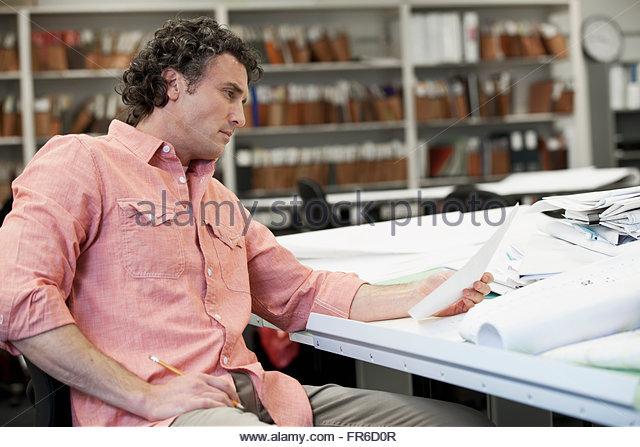 businessman reviewing plans - Stock Image
