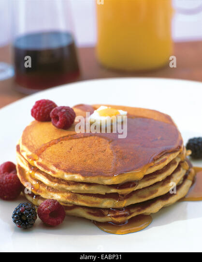 breakfast of pancakes with maple syrup and fruit - Stock Image